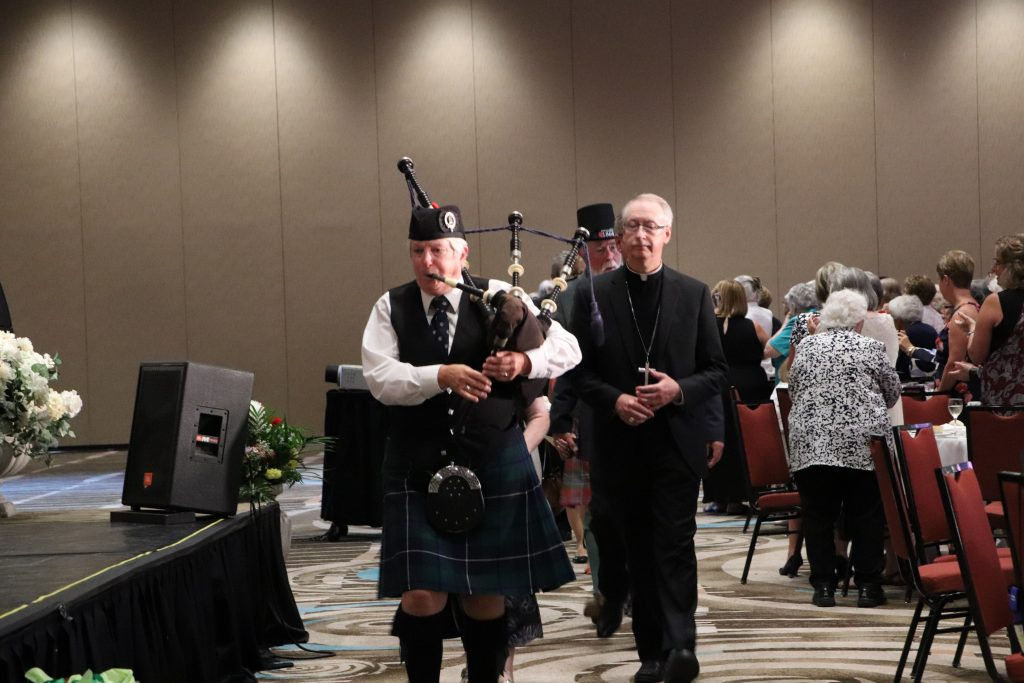 Piper leads the procession for the Gala